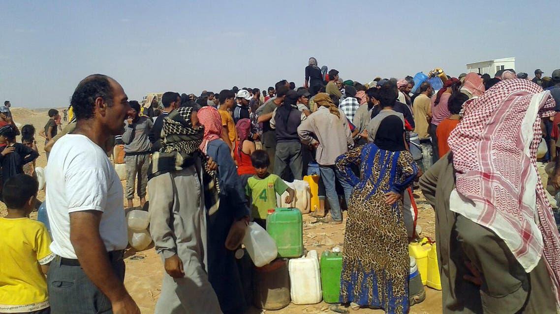 Water reaches Syrian refugees after Jordan border closure (AP)