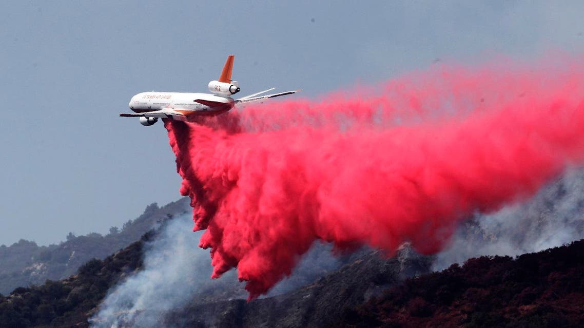 A DC-10 air tanker drops fire retardant in Duarte, California. (AP)