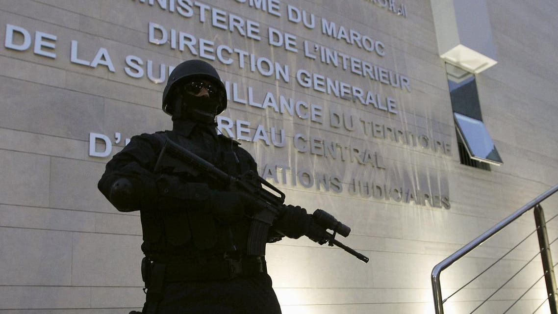 A Moroccan policeman stands guard at the Central Bureau of Judicial Investigation office in Sale, March 23, 2015. (Reuters)