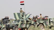 Iraqi flag raised in liberated Fallujah neighborhood