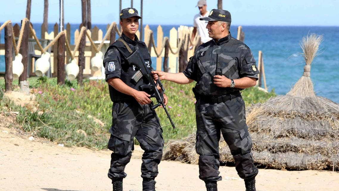 Tunisian policemen stand guard at a beach in the coastal resort of Hammamet, some 60 kms south-east of Tunis, on June 18, 2016.