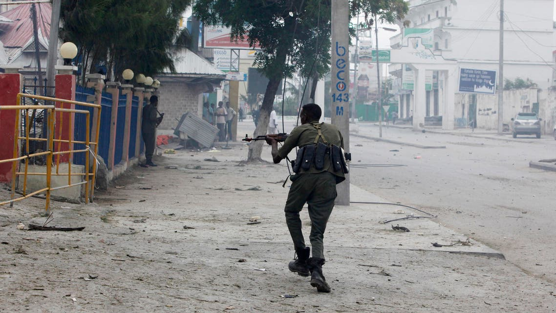 A Somali soldier takes position during an attack on Nasahablod Hotel, in Mogadishu, Somalia, Saturday, a June 25, 2016 . AP