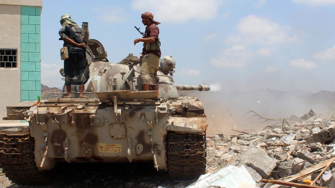 Pro-government forces stand on a tank during clashes with Shiite Huthi militants in Al-Karsh in Yemen's southern Lahj province on May 13, 2016. AFP