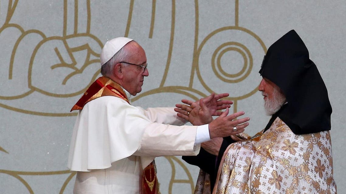 Pope Francis embraces Catholicos of All Armenians Karekin II during an ecumenical service at the Republic Square in Yerevan, Armenia, June 25, 2016. REUTERS