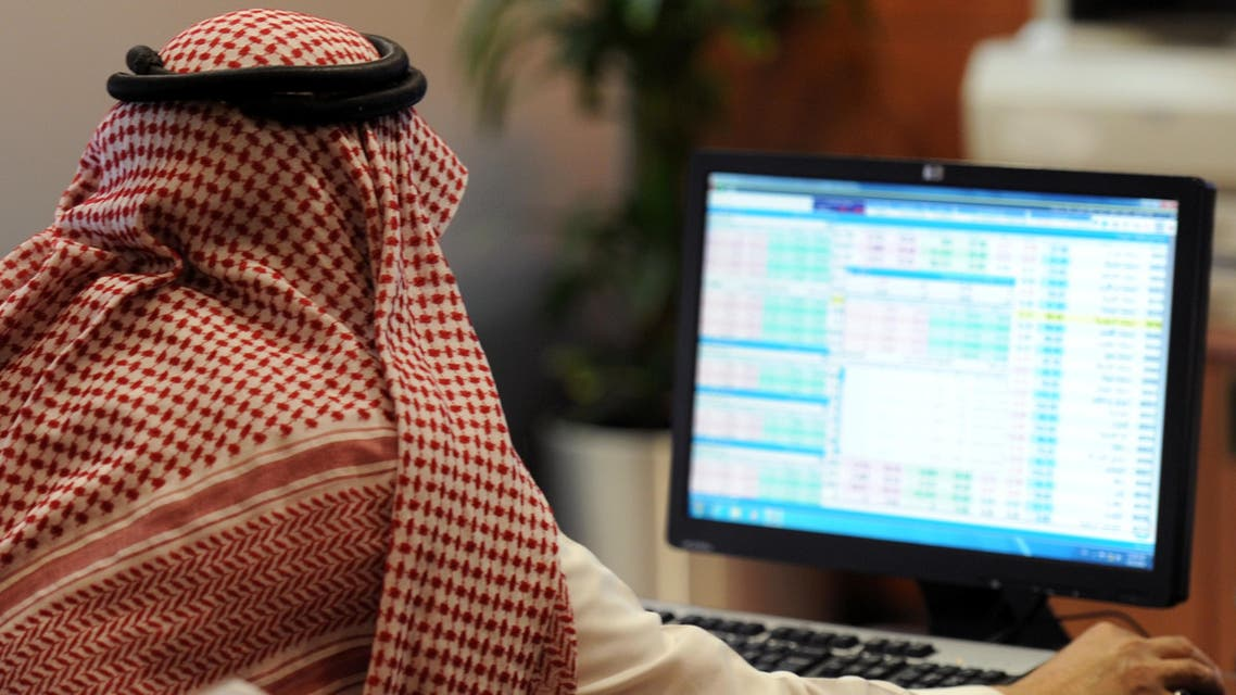 A Saudi investor monitors the stock exchange at the Al-Bilad Saudi Bank on June 15, 2015 in the capital Riyadh. Saudi Arabia's stock exchange allowed foreign investors to trade shares for the first time, boosting efforts by the world's top oil exporter to become a major global capital market. AFP PHOTO / FAYEZ NURELDINE