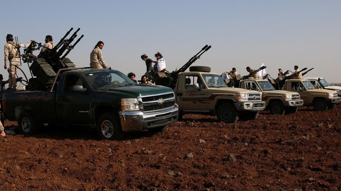 Rebel fighters from 'Mujahideen Horan brigade' stand on pick-up trucks mounted with anti-aircraft weapons as they take part in military training in the western rural area of Deraa Governorate, Syria June 19, 2016. REUTERS