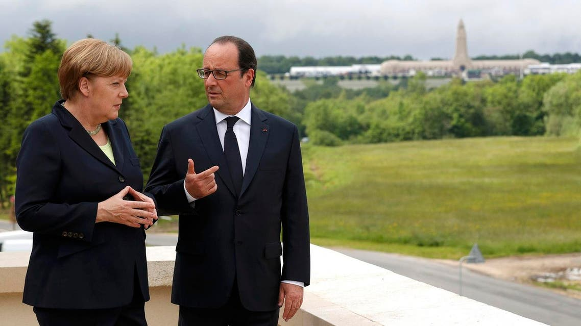 French President Francois Hollande and German Chancellor Angela Merkel stand on the terrace of the new Verdun Memorial with the National Necropolis and Ossuary in the background during a ceremony in Douaumont, France, May 29, 2016, marking the 100th anniversary of the battle of Verdun, one of the largest battles of the First World War (WWI) on the Western Front. REUTERS