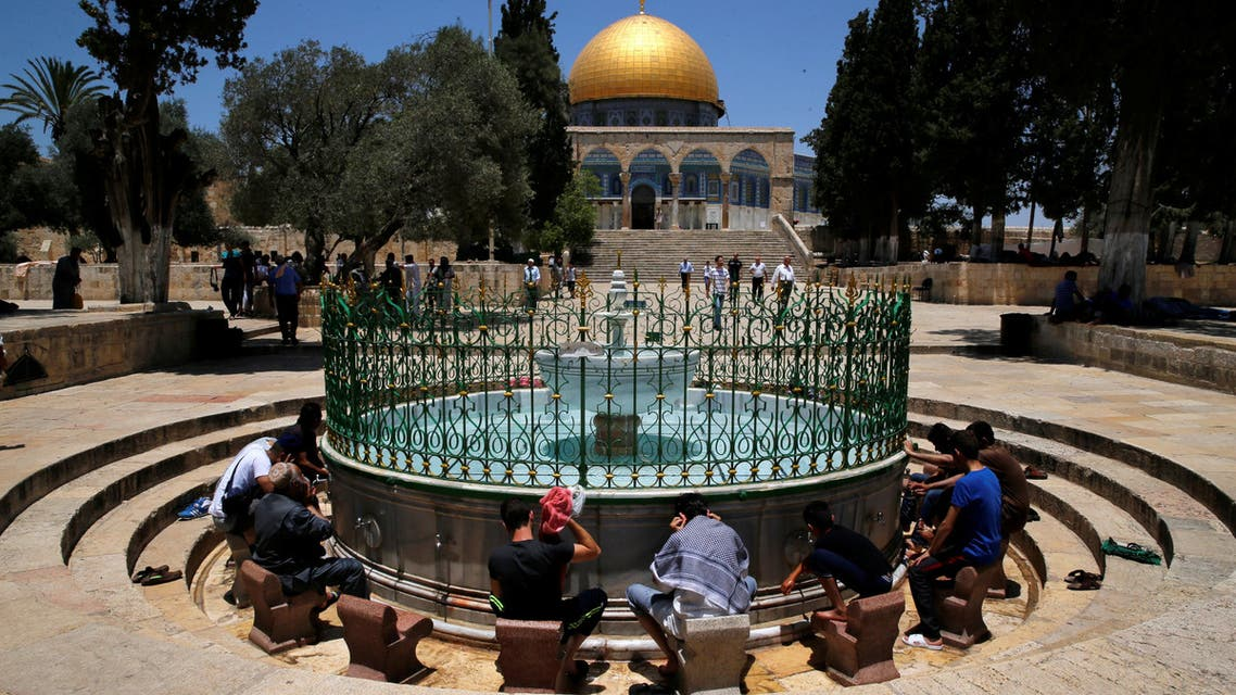 Palestinians clean their hands before prayers during the holy month of Ramadan near the Dome of the Rock on the compound known to Muslims as Noble Sanctuary and to Jews as Temple Mount in Jerusalem's Old City June 26, 2016. AP