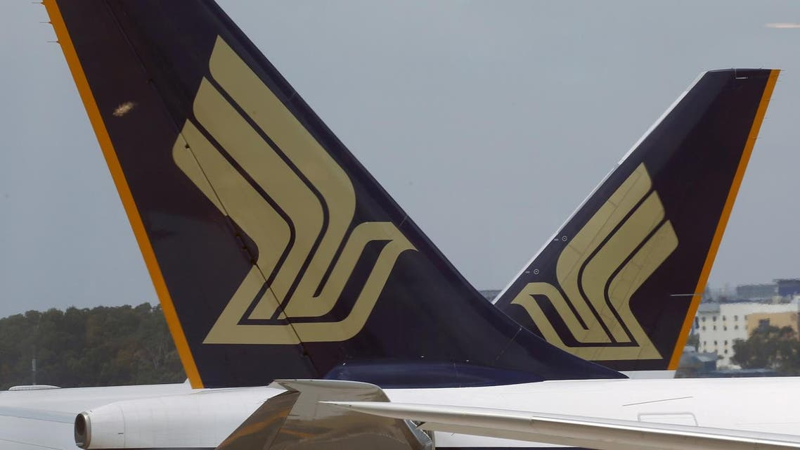 Singapore Airlines (SIA) planes sit on the tarmac in Singapore's Changi Airport March 3, 2016. REUTERS