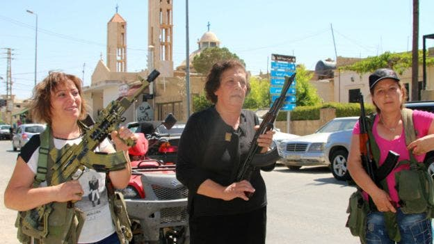 160628080043_lebanese_christian_women_hold_weapons_as_residents_of_the_christian_village_of_al-qaa_640x360_afp_nocredit