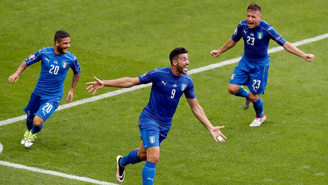 Italy's Graziano Pelle, center, celebrates after scoring his side's second goal during the Euro 2016 round of 16 soccer match between Italy and Spain, at the Stade de France, in Saint-Denis, north of Paris, Monday, June 27, 2016. (AP)