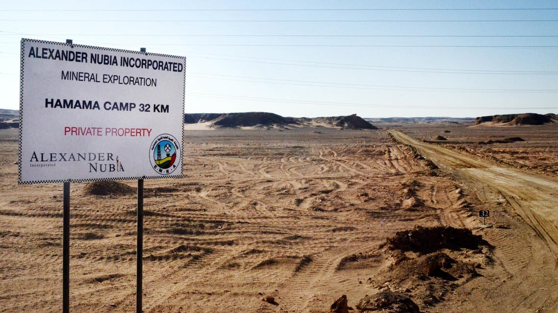 The Friday, April 15, 2016 photo, shows a sign marking the turn-off leading to the Hamama gold exploration site, deep in the desert east of Luxor, Egypt.  AP