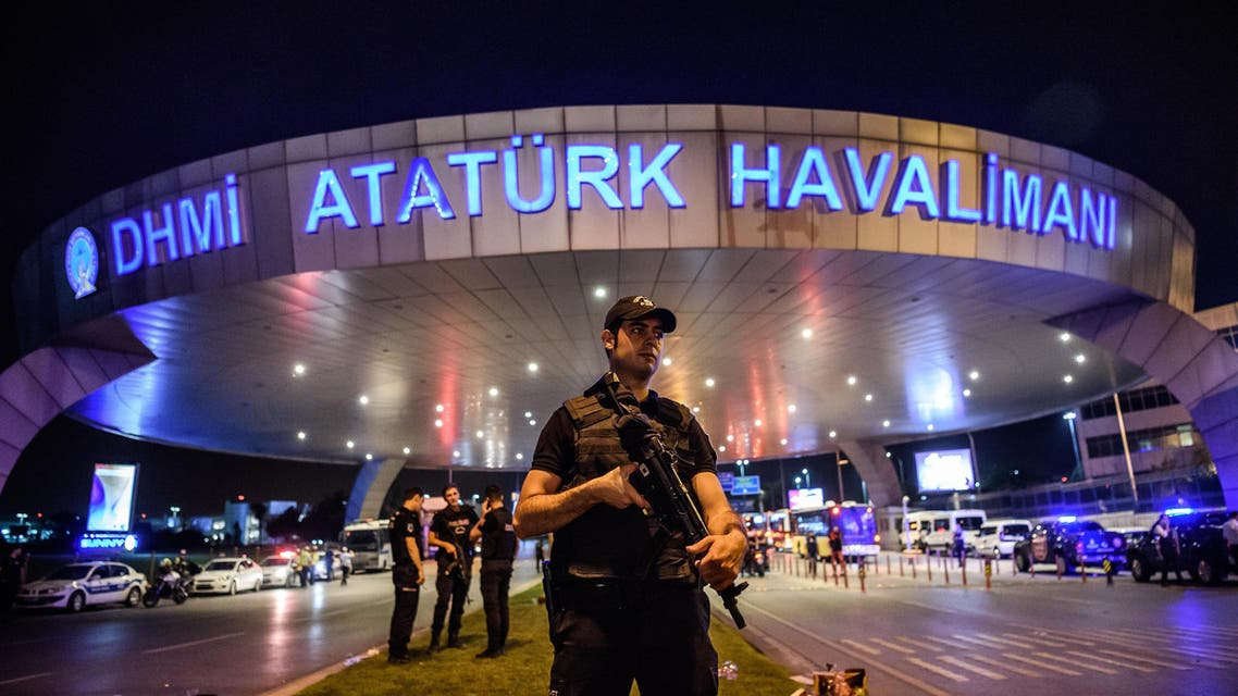A Turkish riot police officer patrols Ataturk airport`s main enterance in Istanbul, on June 28, 2016, after two explosions followed by gunfire hit Turkey's largest airport. (AFP)