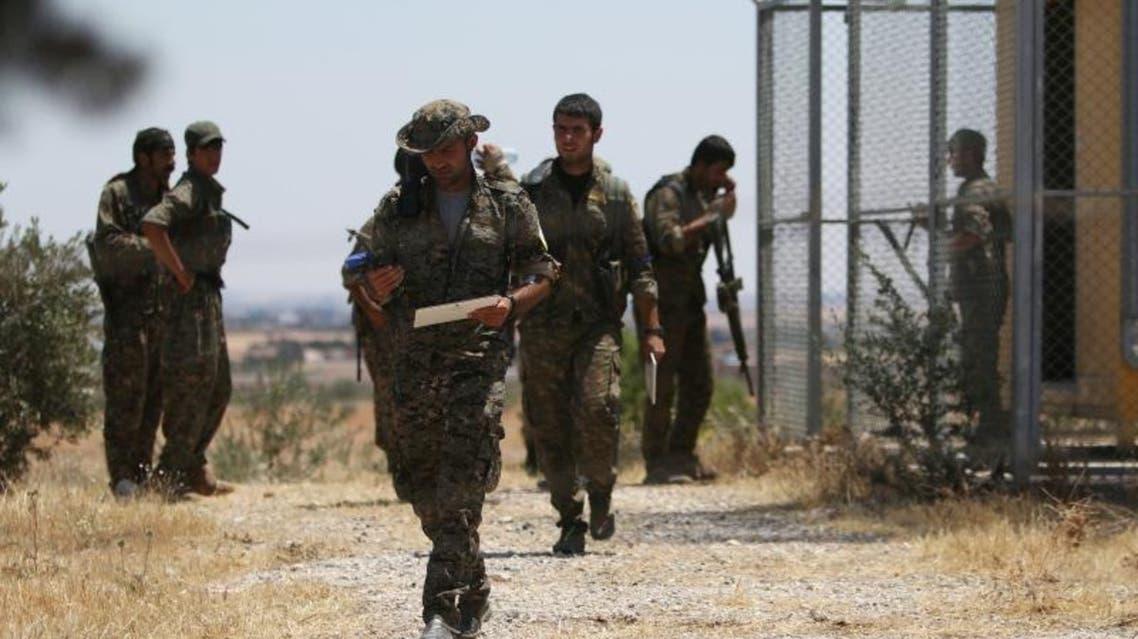 مقاتلون من قوات سوريا الديمقراطية العربية الحدث - رويترز