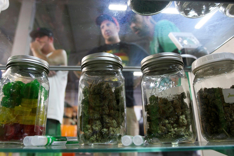 People look at jars of marijuana at the medical marijuana farmers market at the California Heritage Market in Los Angeles, California July 11, 2014. (Reuters)