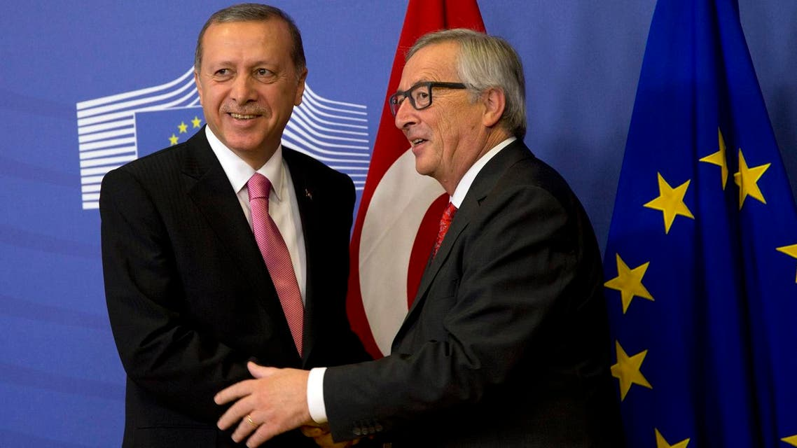 Turkish President Recep Tayyip Erdogan, left, is greeted by European Commission President Jean-Claude Juncker prior to a meeting at EU headquarters in Brussels on Monday, Oct. 5, 2015. Erdogan is on a two-day visit to meet Belgian and EU officials. (AP)