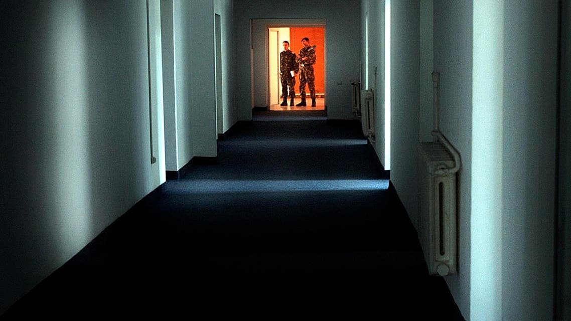 In this Nov. 9, 2005, file picture Romanian military staff stand at the end of a corridor on the Mihail Kogalniceanu airbase, a Soviet-era facility. (AP)
