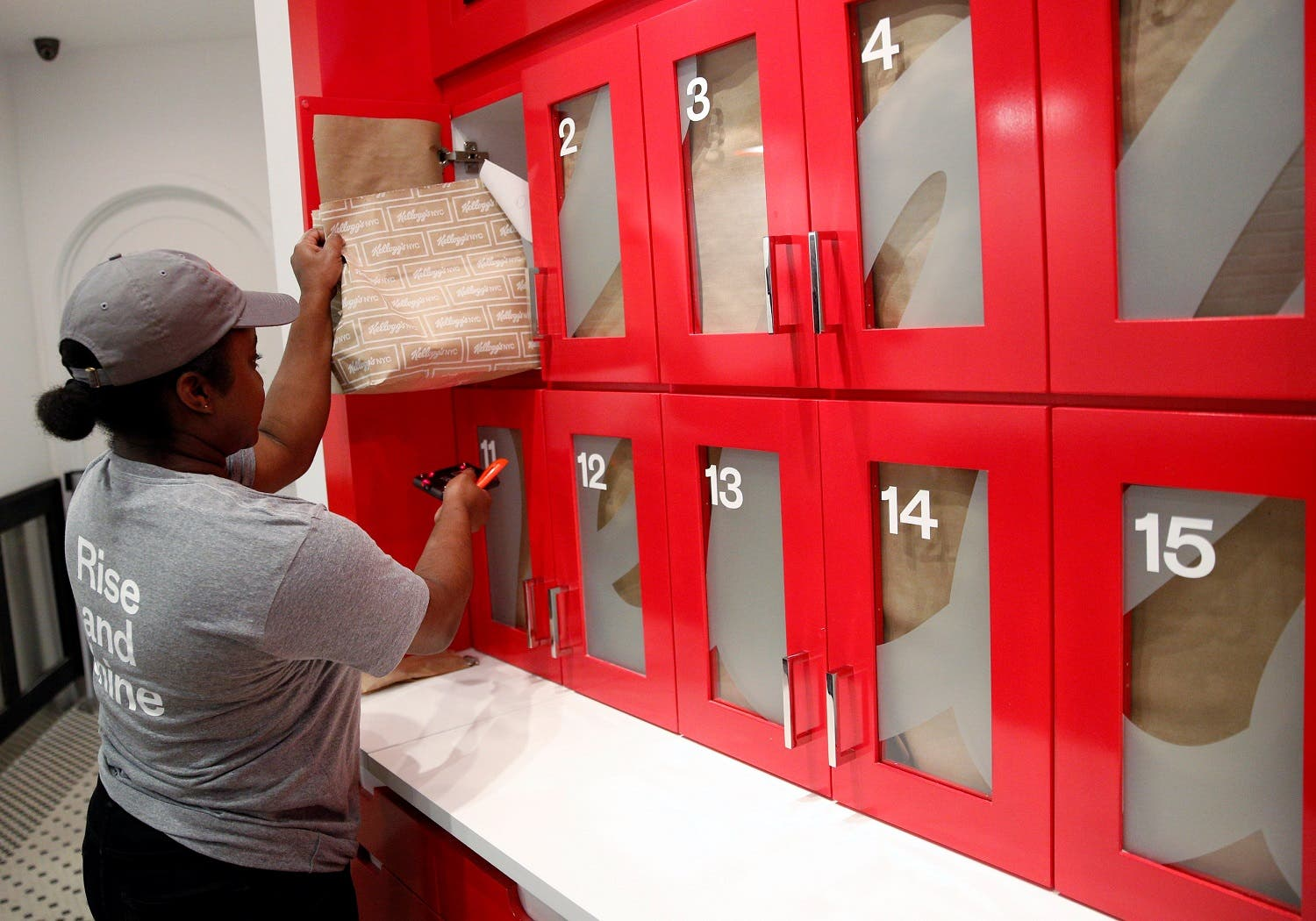 An employee retrieves a cereal order at the Kellogg's NYC cafe in Midtown Manhattan in New York City, U.S., June 29, 2016. REUTERS