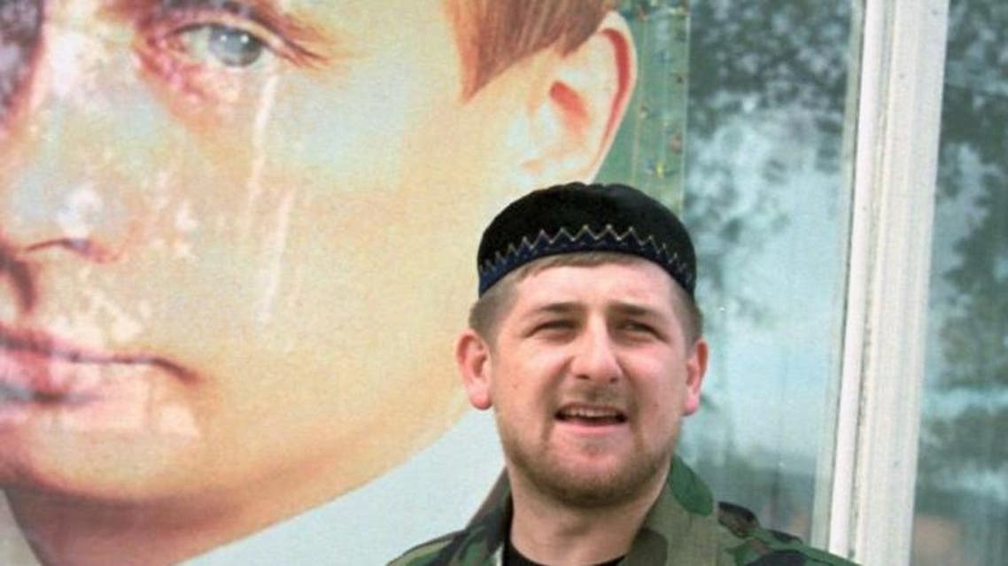 Chechen leader Ramzan Kadyrov poses by a picture of his backer, Russian President Vladimir Putin. (File photo: AFP)