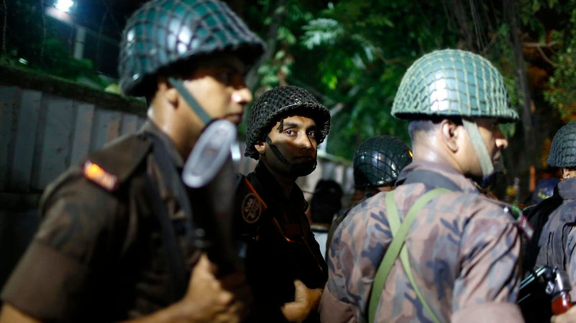 Bangladeshi security personnel stand guard near a restaurant that was attacked by unidentified gunmen in Dhaka, Bangladesh (Photo: AP)
