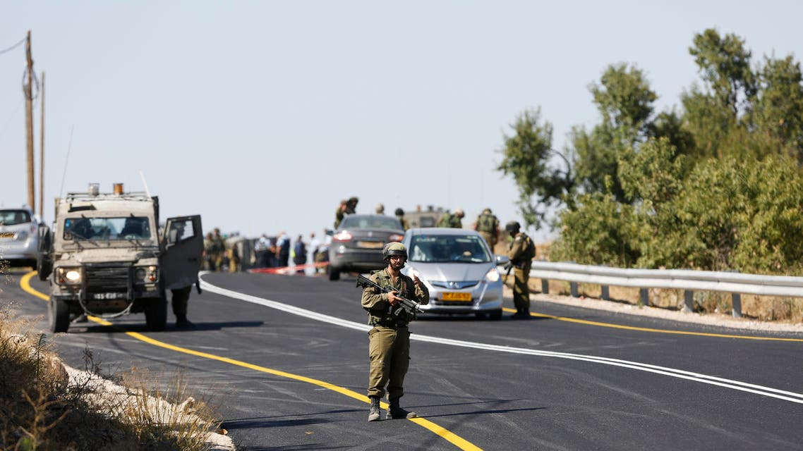 Israeli soldiers secure the scene of a shooting attack near Hebron, West Bank, Friday, July 1, 2016. (AP)
