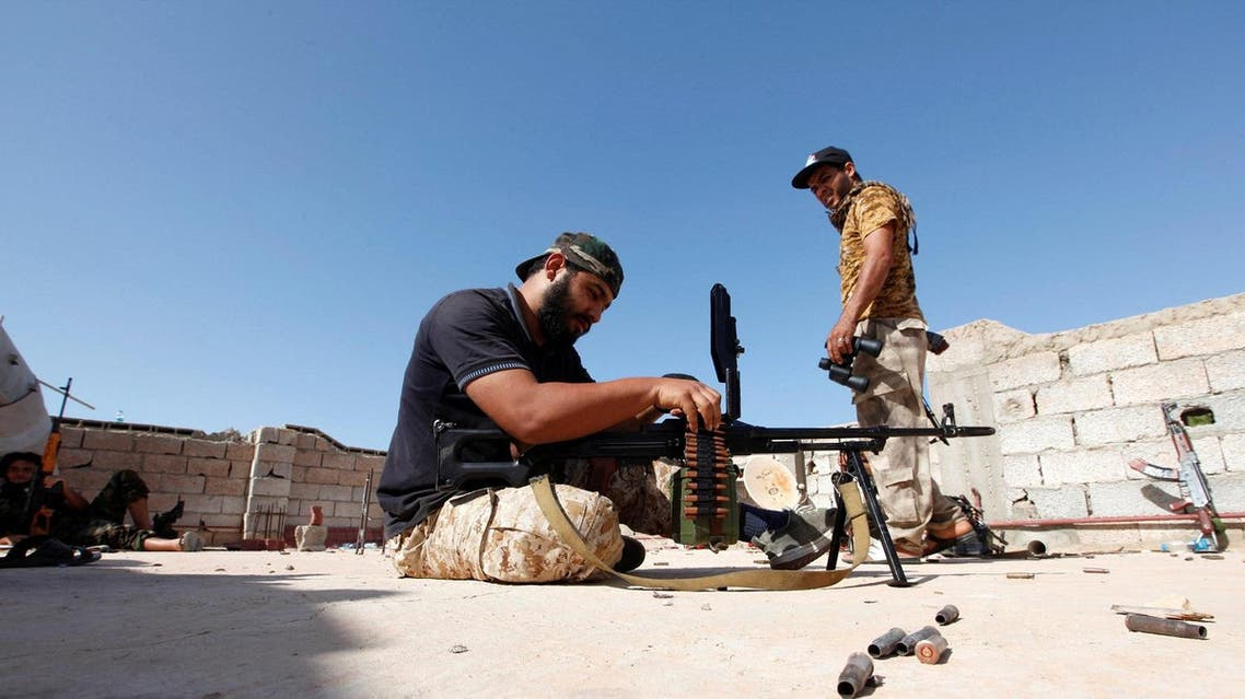 Fighter from forces aligned with Libya's new unity government prepare their weapons in the Zaafran area in Sirte June 30, 2016. REUTERS