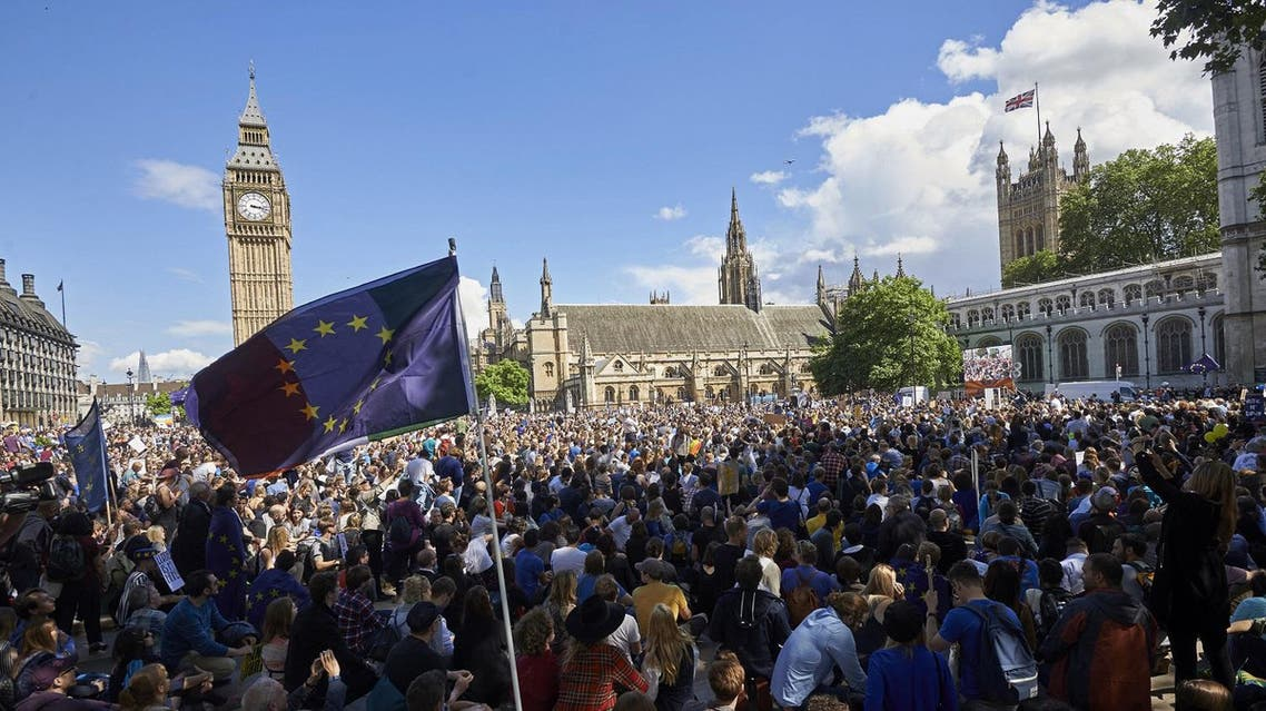 A European flag is flown as thousands of protesters gather in Parliament Square as they take part in a March for Europe, through the centre of London on July 2, 2016, to protest against Britain's vote to leave the EU, which has plunged the government into political turmoil and left the country deeply polarised. Protesters from a variety of movements march from Park Lane to Parliament Square to show solidarity with those looking to create a more positive, inclusive kinder Britain in Europe. Niklas HALLE'N / AFP