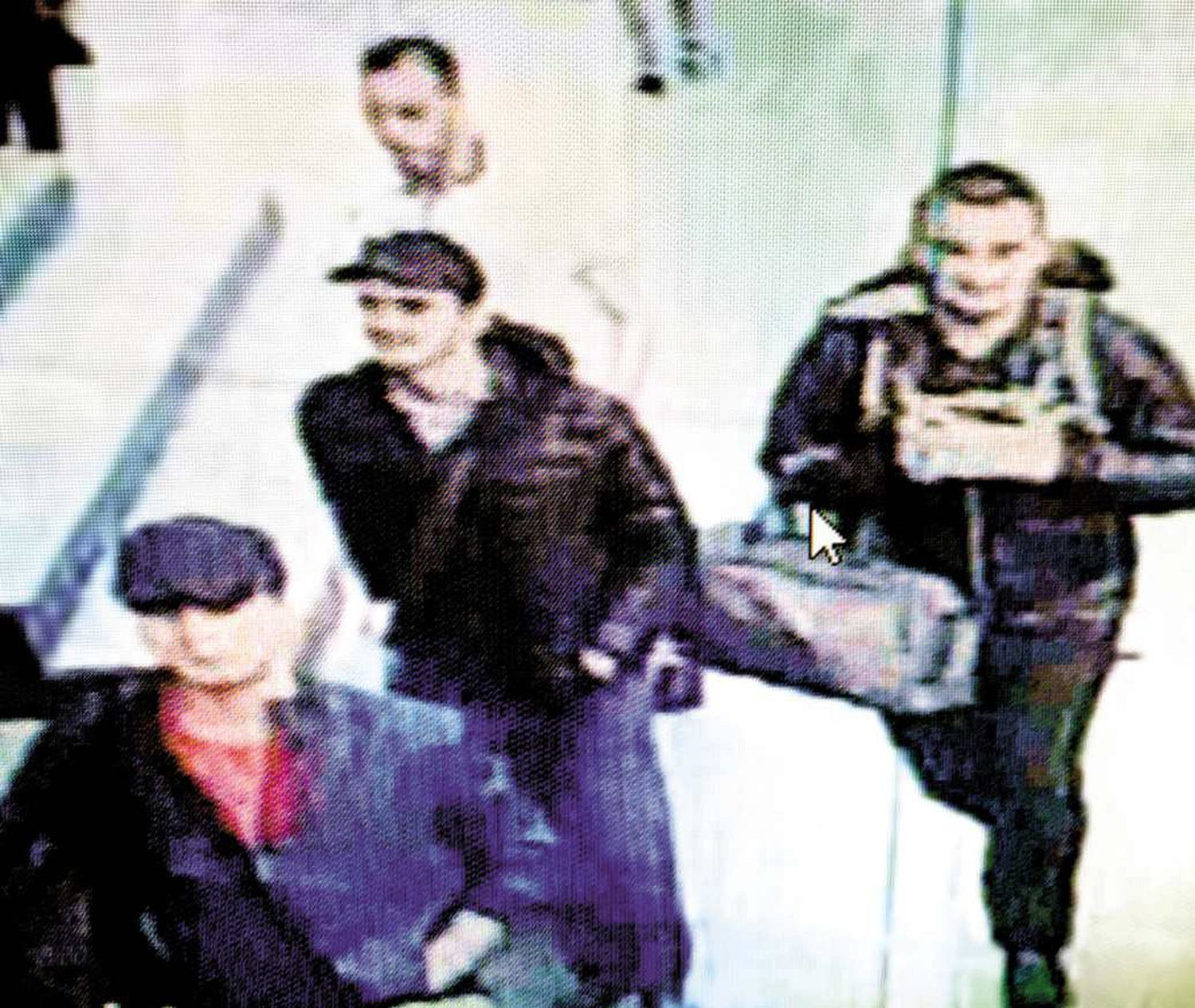 In this framegrab from CCTV video, made available by Turkish police on June 30, 2016, three men (front, in black) believed to be the attackers, walk in Istanbul's Ataturk airport on June 28, 2016 (Photo: Handout/ Istanbul Police Headquarters/AFP)
