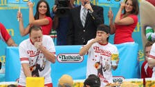 Behind famed NY hot dog contest, a whopper of a legend
