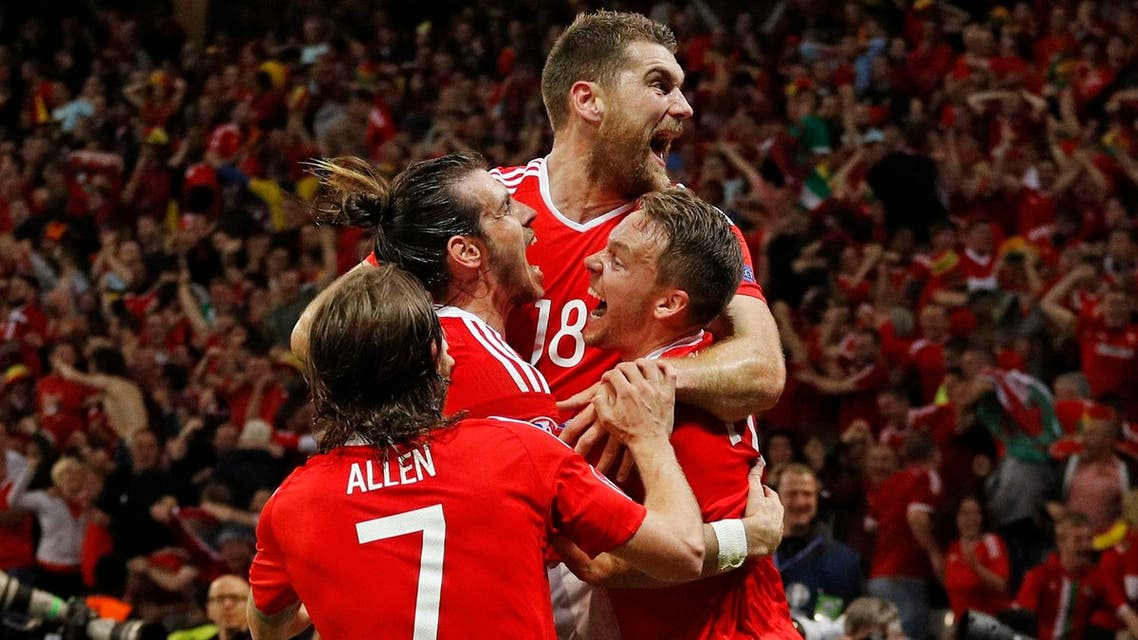 Wales' Sam Vokes celebrates scoring their third goal (Photo: Reuters)