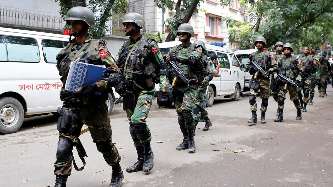 Army soldiers patrol near the Holey Artisan restaurant after gunmen attacked the upscale cafe, in Dhaka, Bangladesh, July 2, 2016. REUTERS