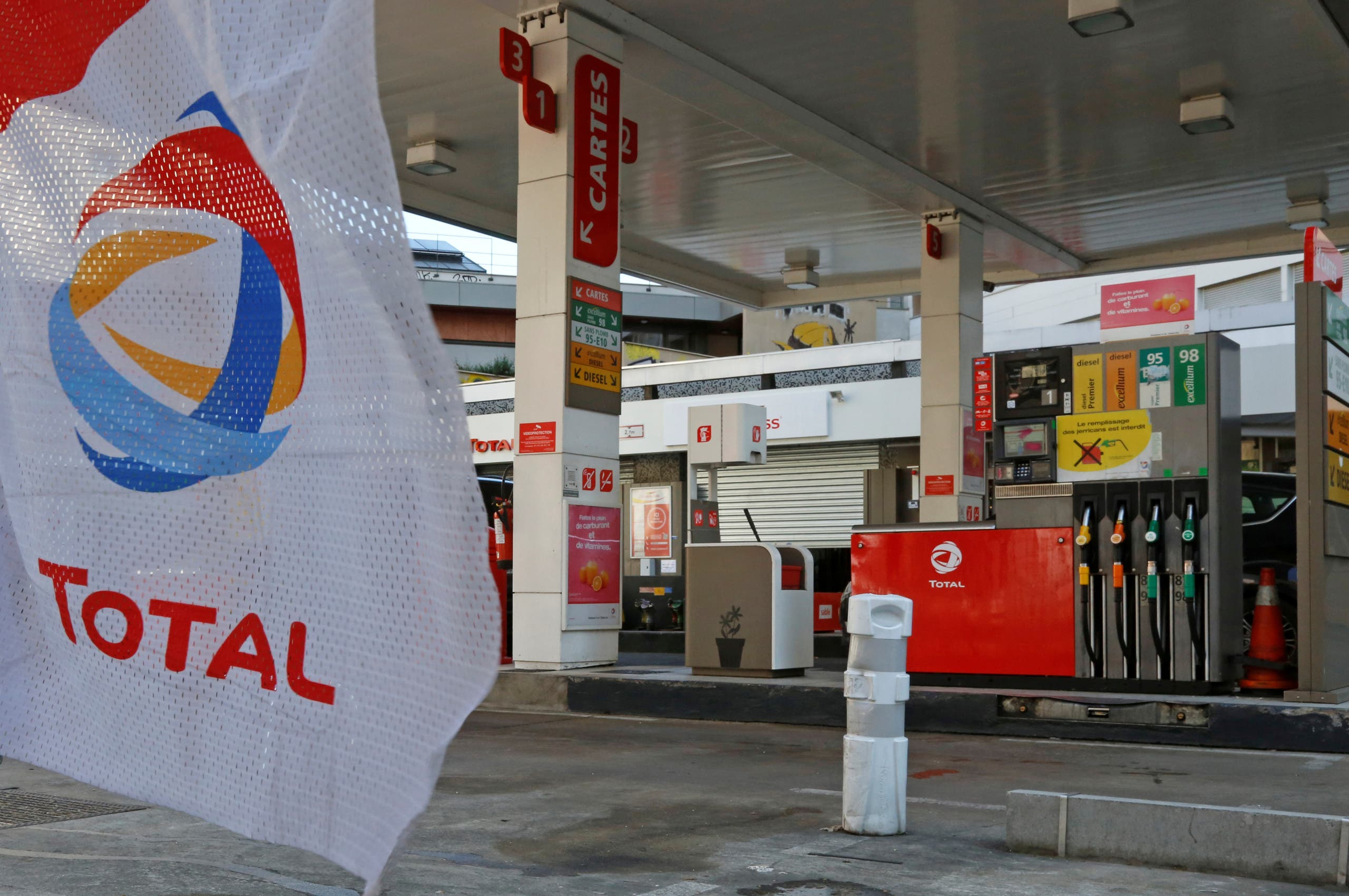 The logo of French oil company Total is seen at a Total gas station in Paris, France. (Reuters)