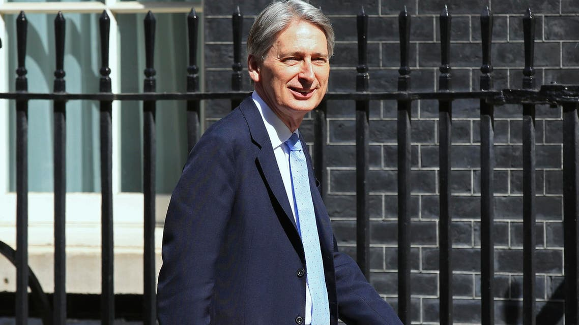 Hammond said the government was taking steps to rehire former civil servants who have trade negotiating skills. (AP)