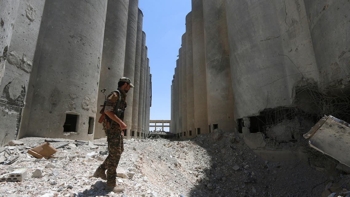 A Syria Democratic Forces (SDF) fighter walks in the silos and mills of Manbij after the SDF took control of it, in Aleppo Governorate, Syria, July 1, 2016. (Reuters)