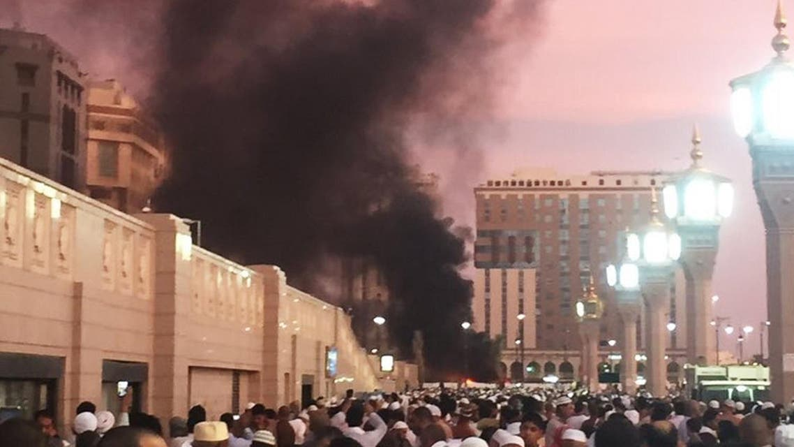 In this photo provided by Noor Punasiya, people stand by the explosion site in Madina, Saudi Arabia, Monday, July 4, 2016 (Photo: Courtesy of Noor Punasiya via AP)