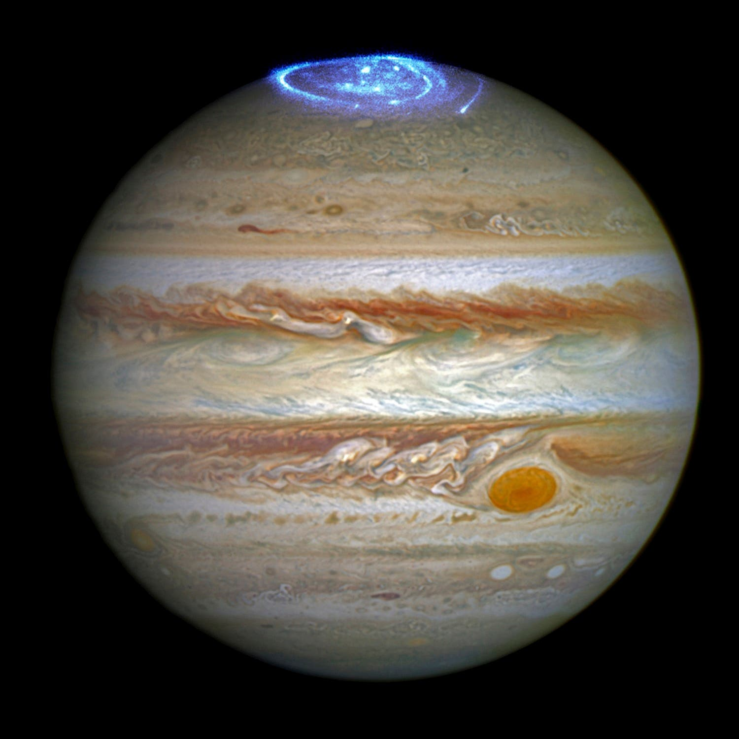 Auroras created by high-energy particles are seen on a pole of the planet Jupiter in a NASA composite of two separate images taken by the Hubble Space Telescope. (Reuters)
