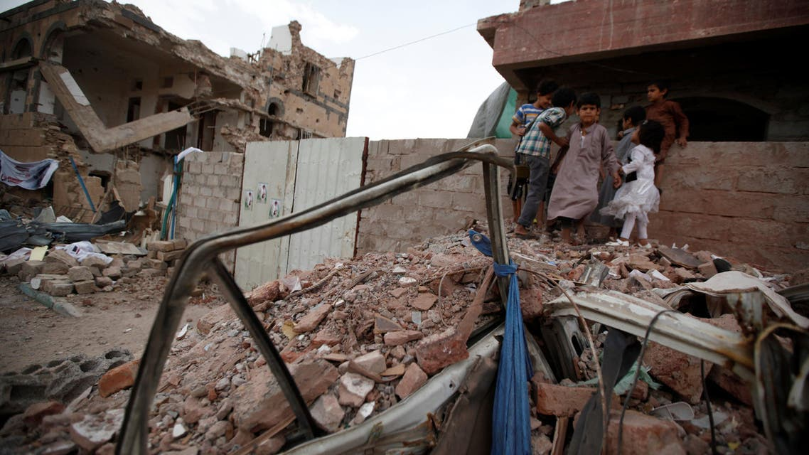 Children play next to houses destroyed in a residential area in Sanaa, Yemen June 21, 2016. (Reuters)