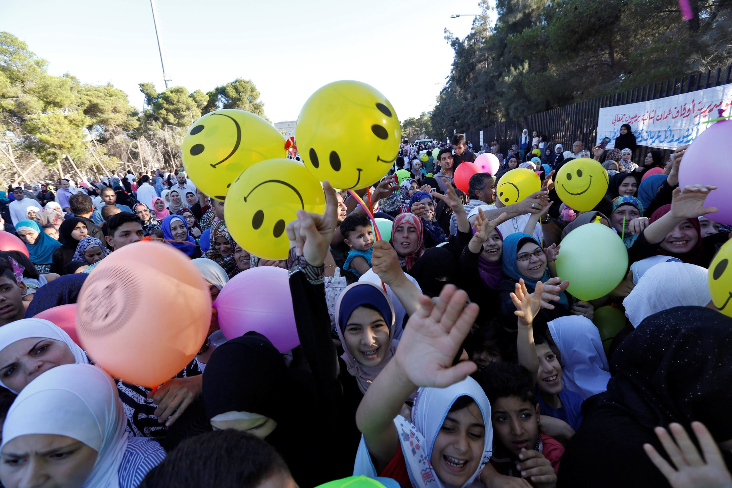Muslim children race to get balloons after the prayers of Eid al-Fitr marking the end of the holy fasting month of Ramadan in Amman, Jordan, July 6, 2016. (Reuters)