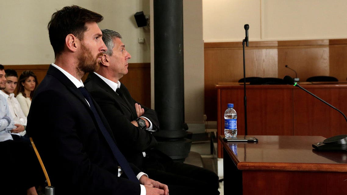 Barcelona's Argentine soccer player Lionel Messi (L) sits in court with his father Jorge Horacio Messi during their trial for tax fraud in Barcelona, Spain, June 2, 2016. REUTERS