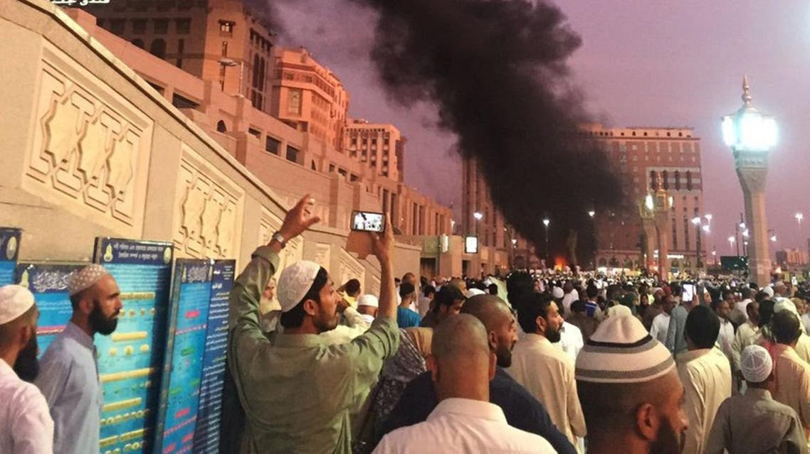In this photo provided by Noor Punasiya, people stand by an explosion site in Madinah, Saudi Arabia, Monday, July 4, 2016. (AP)