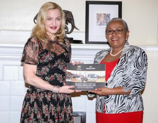 Singer-songwriter Madonna Ciccone (L) poses for a photograph with Kenyan First Lady Margaret Kenyatta as she receives a 'Beyond Zero' campaign technical report at State House in Nairobi, Kenya, July 4, 2016. (Reuters)