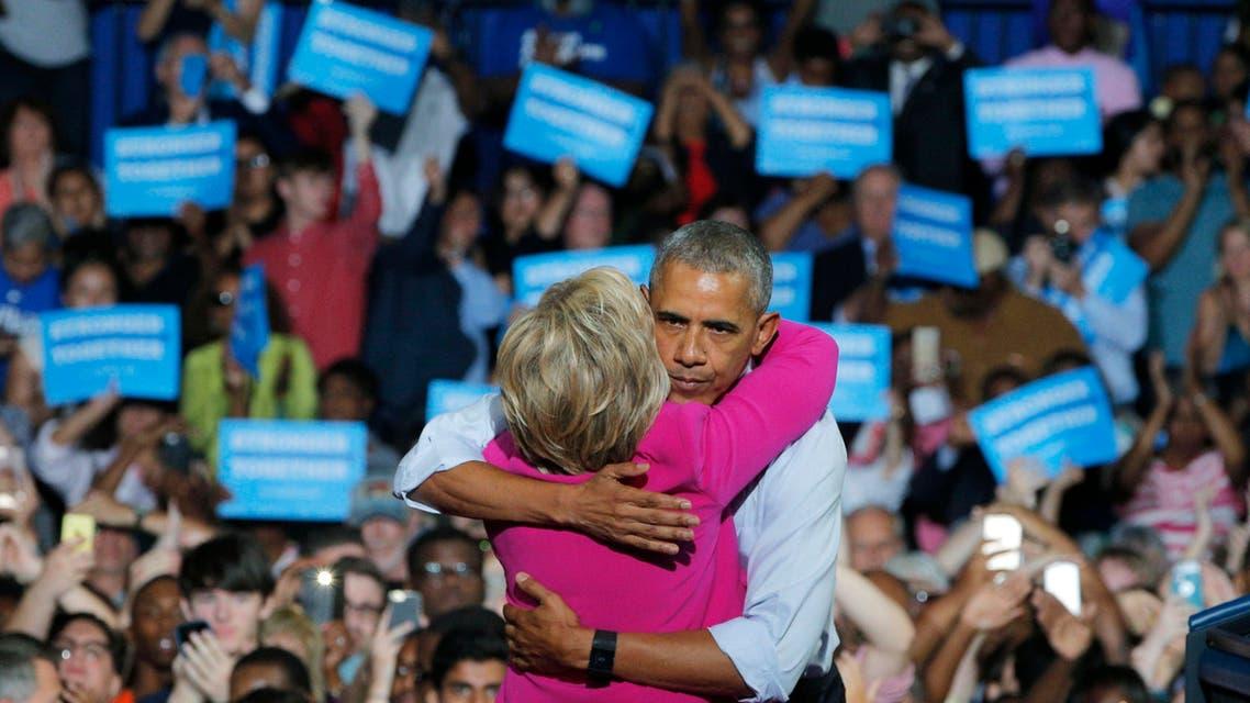 U.S. President Barack Obama embraces Democratic U.S. presidential candidate Hillary Clinton during a Clinton campaign event in Charlotte, North Carolina, U.S., July 5, 2016. REUTERS/Brian Snyder