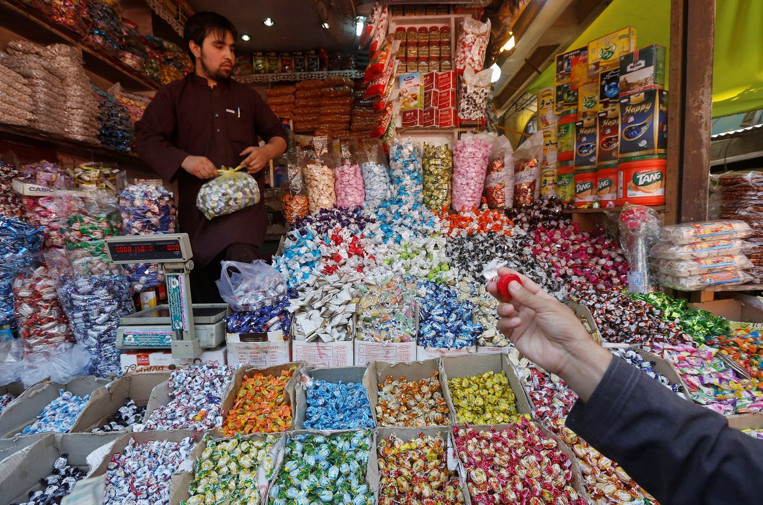 People shop for festive goodies in preparation for Eid al-Fitr in Kabul, Afghanistan July 4, 2016. REUTERS