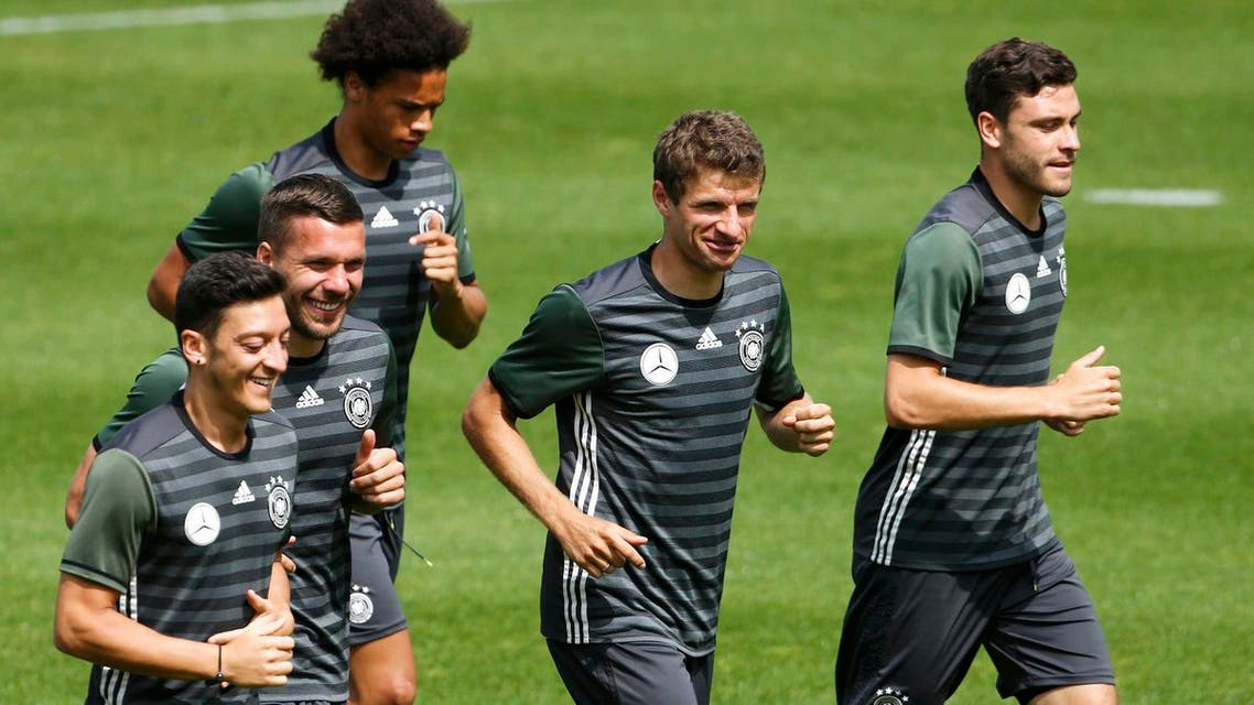 Germany's Mesut Oezil, Lukas Podolski, Thomas Mueller and Jonas Hector during training. REUTERS