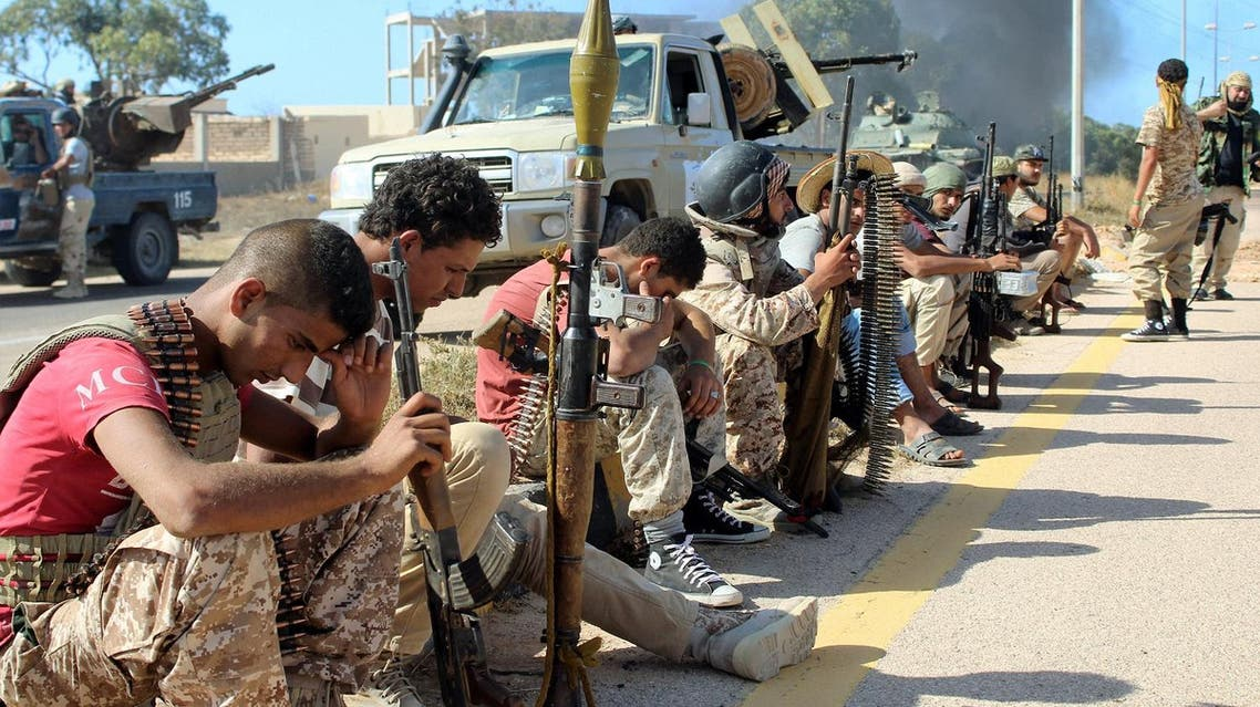 Soldiers from forces aligned with Libya's new unity government are seen resting on the road during an advance on the Islamic State stronghold of Sirte, June 8, 2016. REUTERS