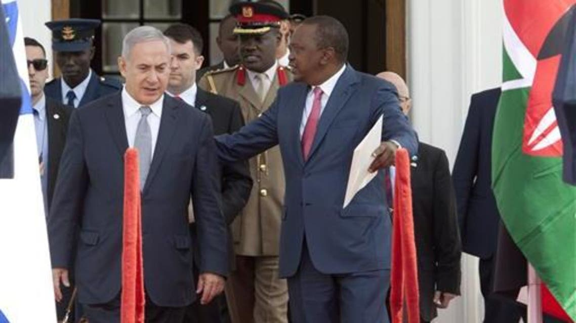 Israeli Prime Minister Benjamin Netanyahu, left, and Kenyan President Uhuru Kenyatta walk together to give a joint press conference at State House in Nairobi, Kenya, Tuesday, July 5, 2016. AP