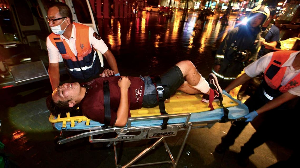 An injured man is helped by emergency rescue workers after an explosion on a passenger train in Taipei, Taiwan, Thursday, July 7, 2016 (Photo: AP)