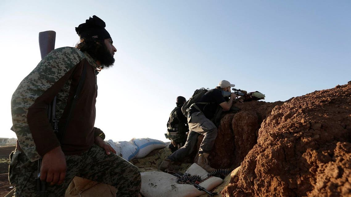 Rebel fighters from 'Jaysh al-Sunna' stand on a look-out point in the southern Aleppo countryside, Syria June 10, 2016. REUTERS