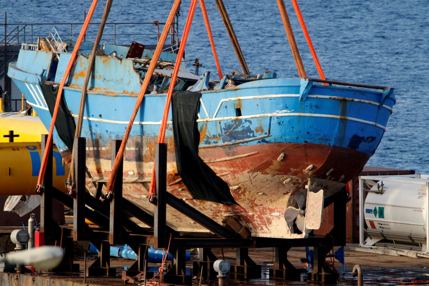 The wreck of a fishing boat that sank in April 2015, drowning hundreds of migrants packed on board, is seen after being raised in the Sicilian harbour of Augusta, Italy, July 1, 2016. REUTERS