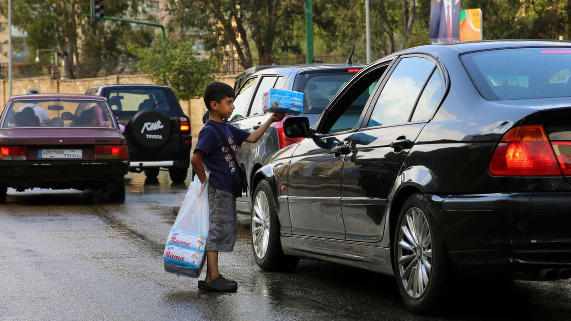 In this Saturday, May 28, 2016, Syrian street vendor Ali Hamadah, who fled with his family from Aleppo, Syria, sells tissues for drivers in Beirut, Lebanon. (AP)
